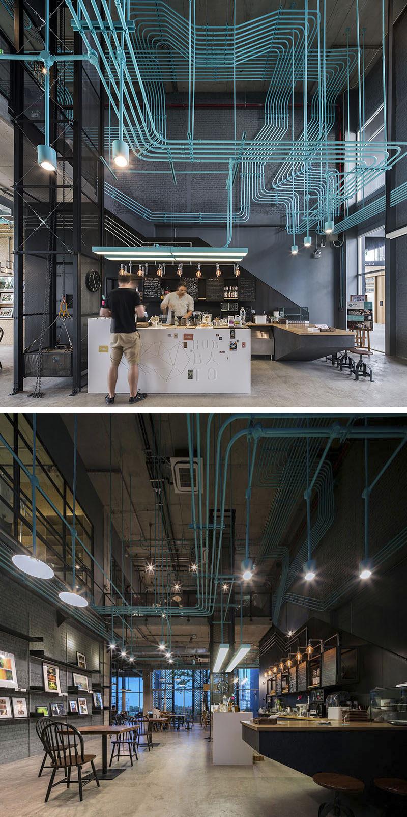 10 cửa hàng cà phê độc đáo ở Châu Á / Supermachine Studio và nhà phát triển Sansiri thiết kế cửa hàng cà phê văn phòng làm nổi bật hệ thống đường dây điện bằng cách sơn nó một màu ngọc lam sáng để cho nó một niềm vui, công nghiệp nhìn.
