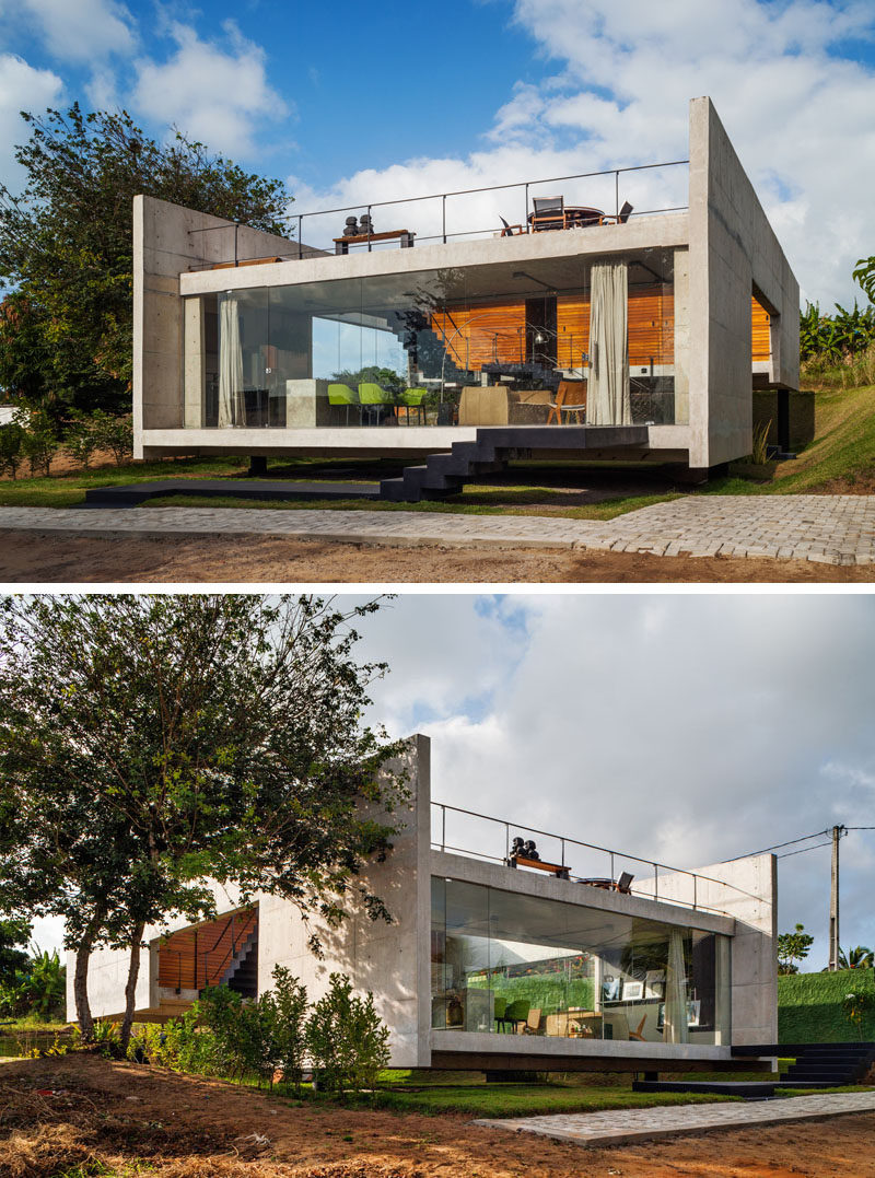 13 Modern House Exteriors Made From Concrete | The mostly concrete exterior of this house gives it a rough look that's softened and warmed up by the use of wood at the back of the house.