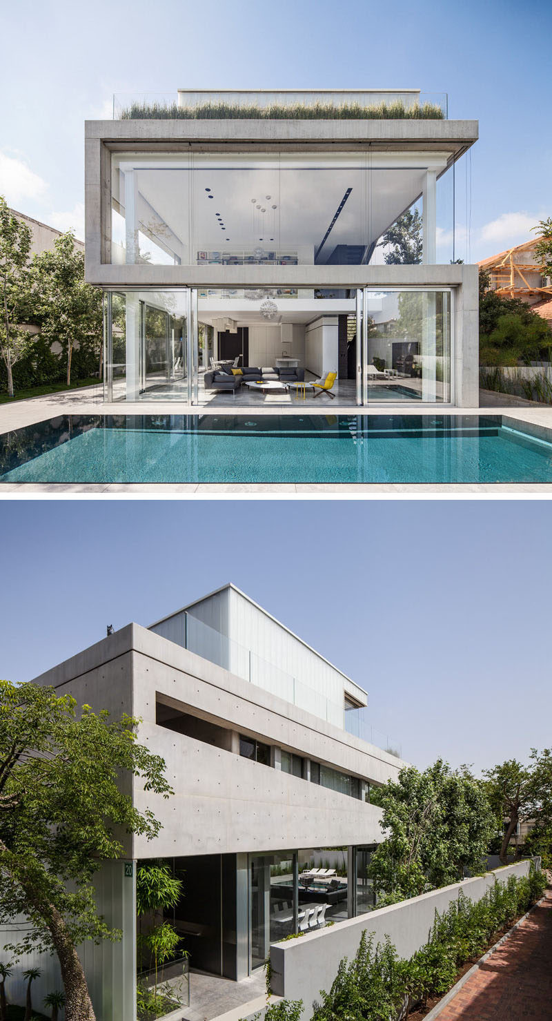 13 Modern House Exteriors Made From Concrete | Concrete and glass have been used for the design of this modern home to keep it bright, airy, and open.