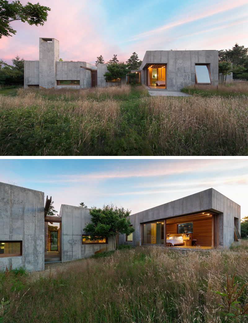 13 Modern House Exteriors Made From Concrete | This concrete house surrounded by nature has been designed to make the most of the landscape, and features sliding doors and tilting windows to make it easy to feel outside even when you're in bed.