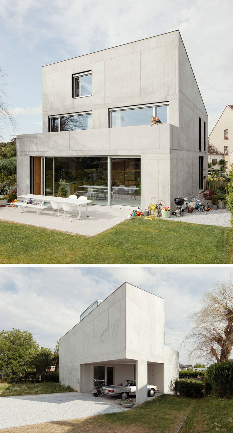 13 Modern House Exteriors Made From Concrete | The solid concrete wall at the front of this house is a strong contrast to the more open back of the home.