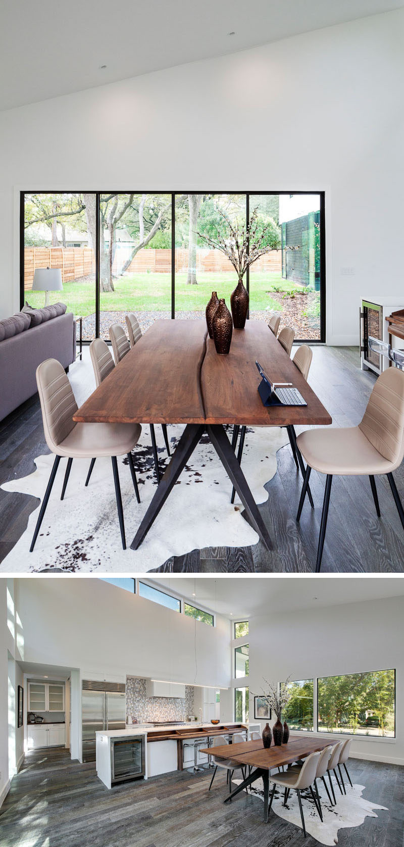 The interior of this modern house has a dining area with views of the backyard, and the wood dining table ties in with the tall trees outside.