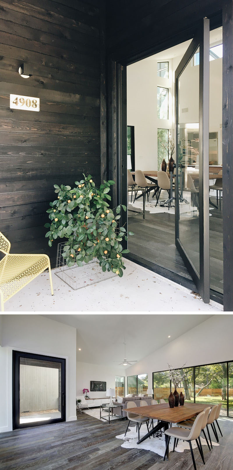 The covered entryway on this modern house leads to the front door, and instead of a more traditional solid wood door, the house has a large pivoting glass door, allowing guests to see into the home or the occupants to see out.