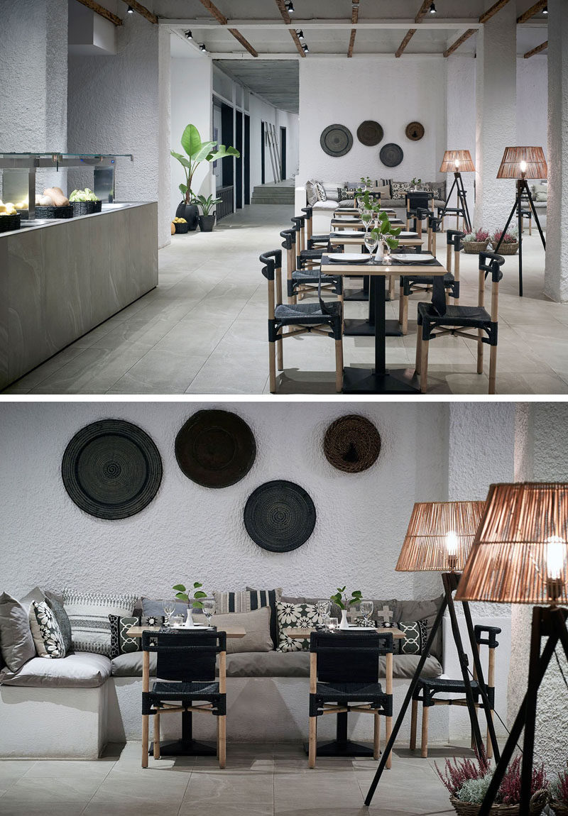 This modern hotel restaurant has both indoor and outdoor seating, and in keeping with the rest of the hotel design, has a simple interior of white textured walls, banquette seating, stone floors, and natural elements throughout.