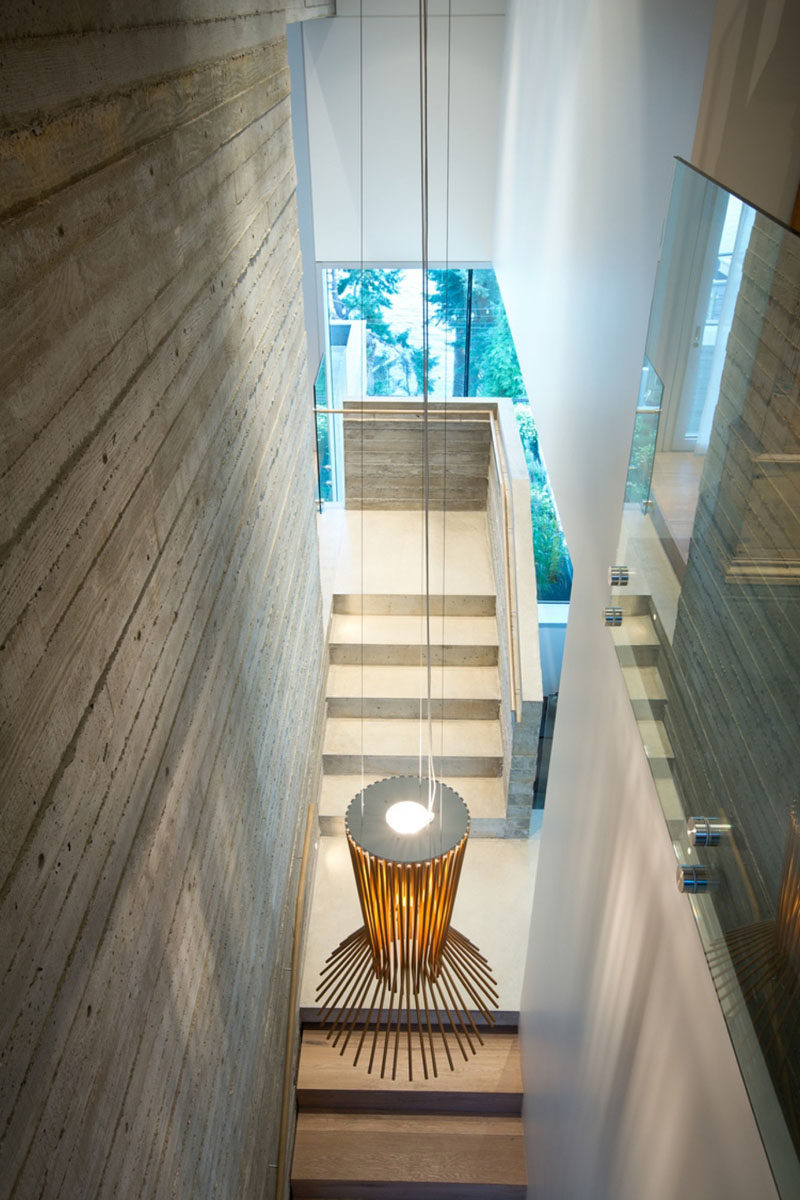 Board formed concrete used on the interior of this modern house mimics the texture of the wood siding found on the exterior.