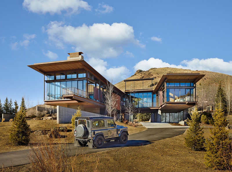 This modern mountain house is filled with industrial for Modern mountain house