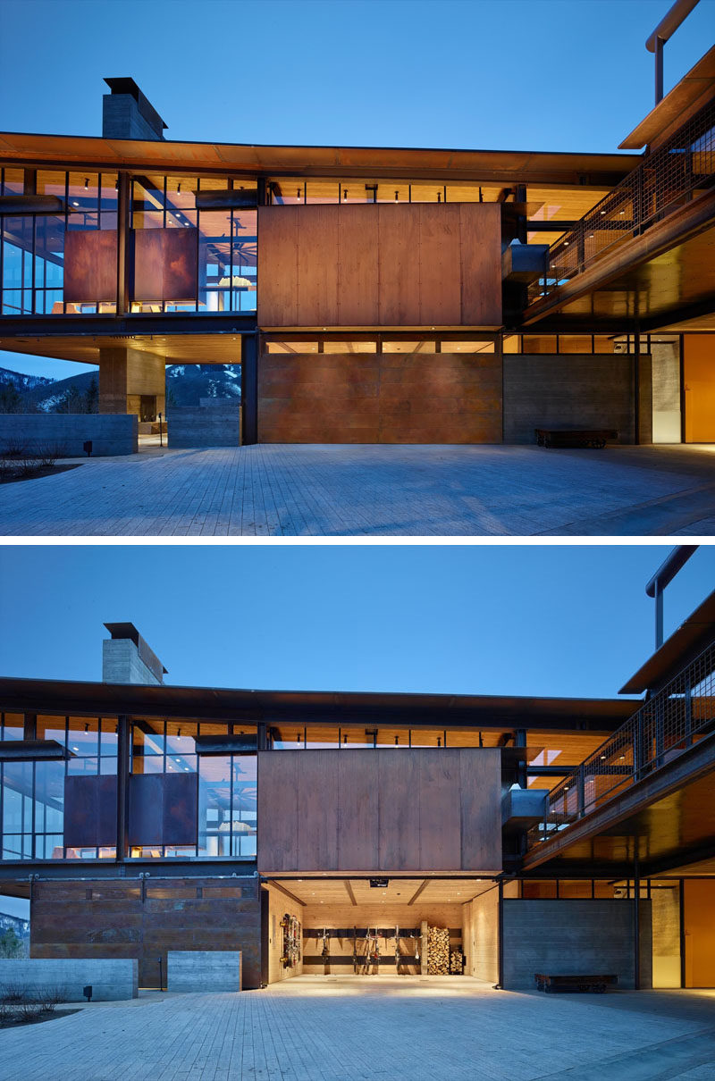 The roof of this modern industrial home is made of corrugated weathered steel that slopes slightly and matches the garage door.