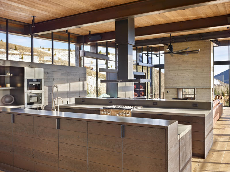 This kitchen is made up of two islands that create a galley-like appearance, with the cooktop on one island and the sink on the other.