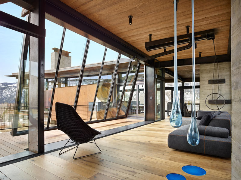 This huge glass wall is twenty-five feet long and pivots to open. The wall is counterbalanced overhead by a large steel weight that sits five feet above the roof. Attached to the wall is a hand-wheel crank with an eight-foot long screw that is used to open it.