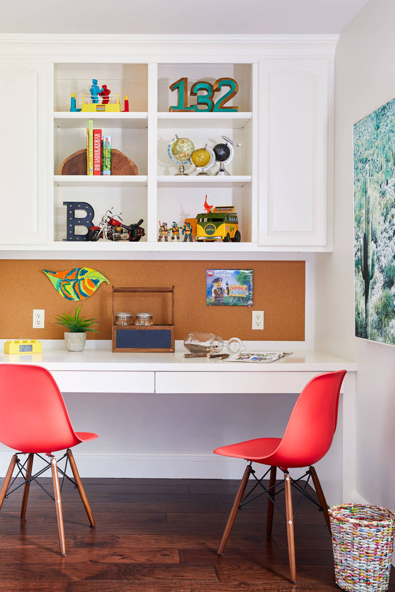 This kids bedroom design features a homework station along one wall, and a custom bulletin board provides the perfect place to pin inspiration, photos, or notes.