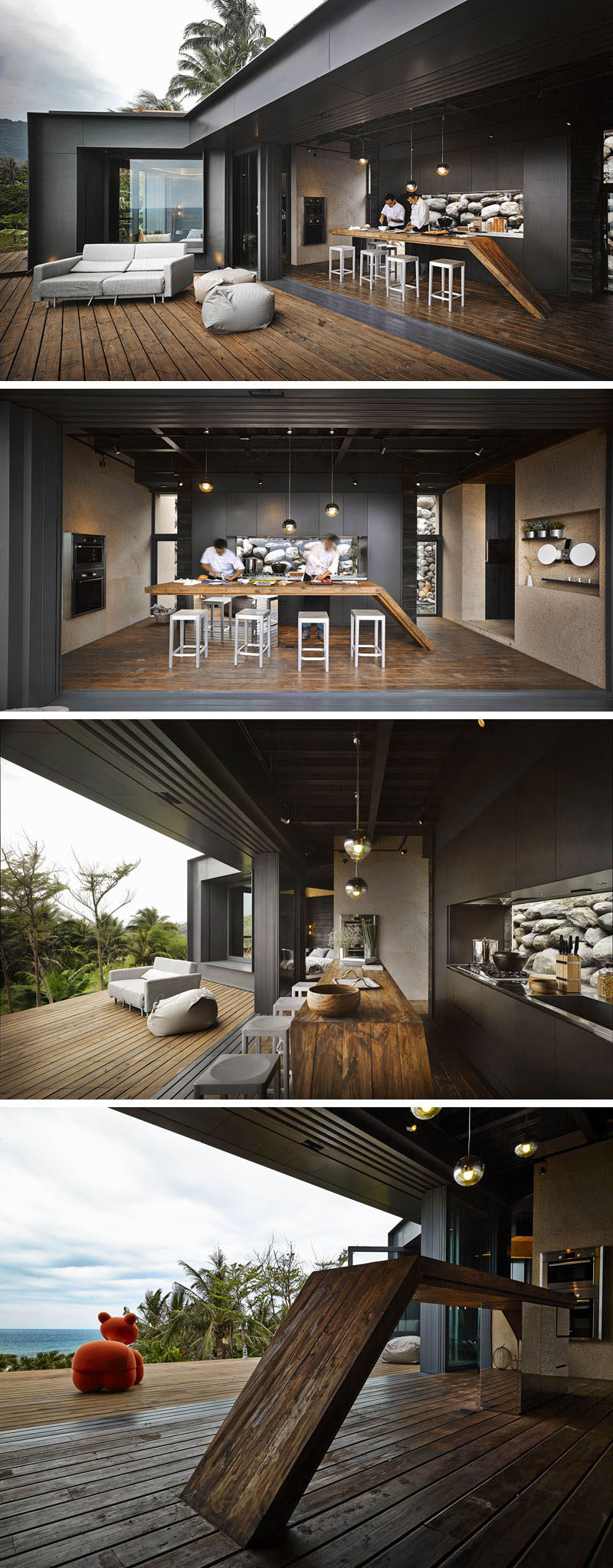 This black kitchen with a wooden countertop opens up to the deck for complete indoor/outdoor living. By using clear glass for the kitchen backsplash, it lets the rocks in the garden appear as a piece of art, and when needed, the kitchen can be closed off to the elements with accordion glass doors.