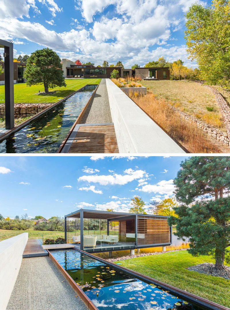 This contemporary home has multiple yard areas and there's a path that separates them. A long water feature runs alongside the path, and at the end of the water feature there's a cabana with outdoor living room.