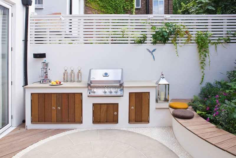 This modern landscaped garden has a bespoke outdoor kitchen with a bbq, counter space and storage. The garden also has a sound and lighting system as well as automatic irrigation.