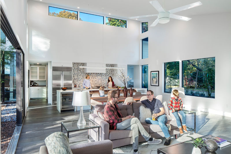 This modern house has an open floor plan with the living, dining and kitchen all sharing the same main room. Tall ceilings made the space feel even larger than it already is.