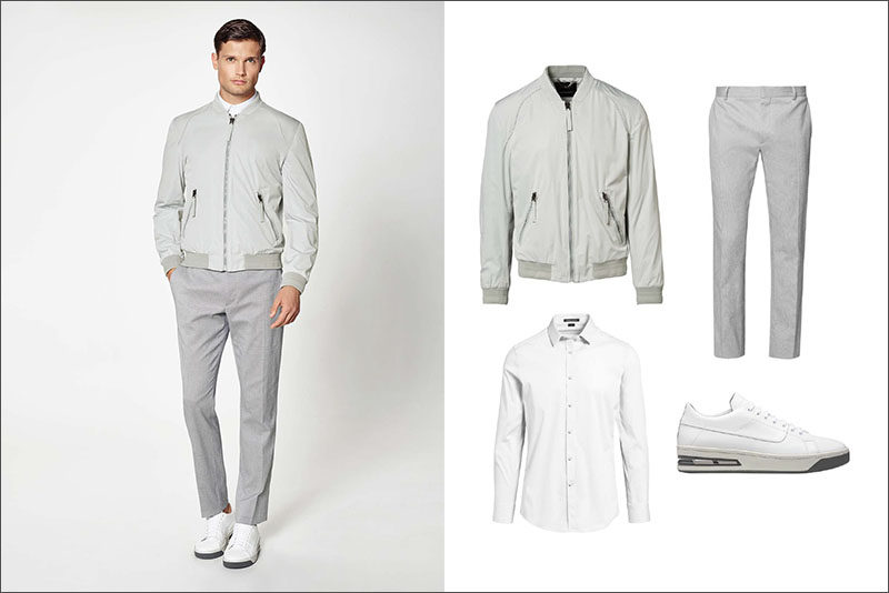 Men's Fashion Ideas - 17 Men's Outfits From Porsche Design's 2017 Spring/Summer Collection | This sophisticated yet casual men's outfit was created using a simple light grey jacket, a pair of light grey trousers, a crisp white collared shirt, and clean white sneakers.