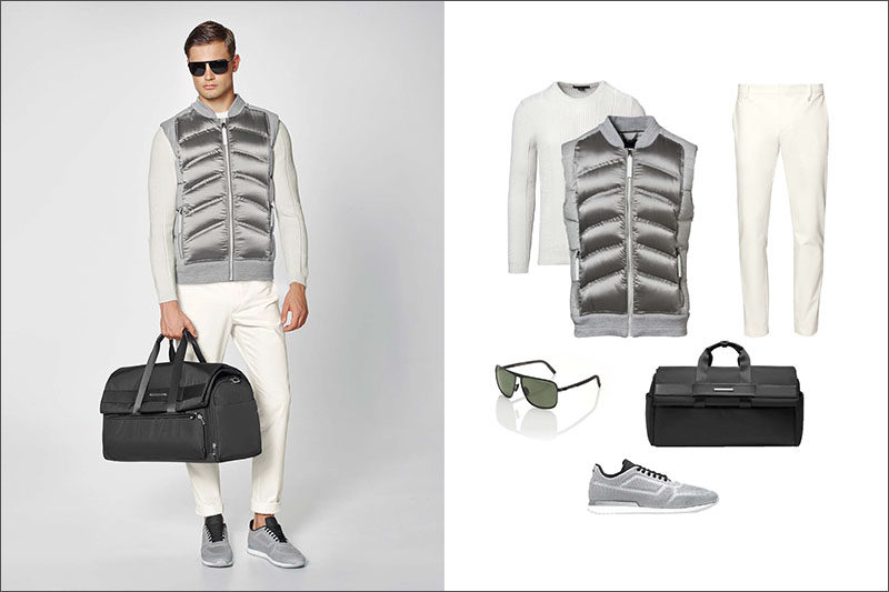 Men's Fashion Ideas - 17 Men's Outfits From Porsche Design's 2017 Spring/Summer Collection | White cotton pants, a white crew neck sweater, and a metallic quilted vest are accessorized with a black weekender bag, dark sunglasses, and light grey mesh sneakers.