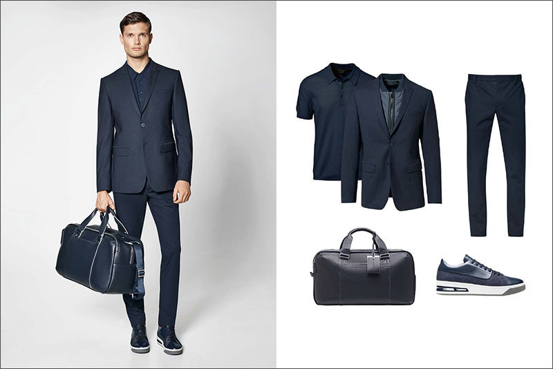 Men's Fashion Ideas - 17 Men's Outfits From Porsche Design's 2017 Spring/Summer Collection | This monochrome men's outfit pairs a slim fitting navy blazer with a navy knit polo shirt, crisp navy cotton pants, casual navy sneakers, and navy leather weekend bag.