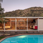 This modern backyard pool house is designed for entertaining