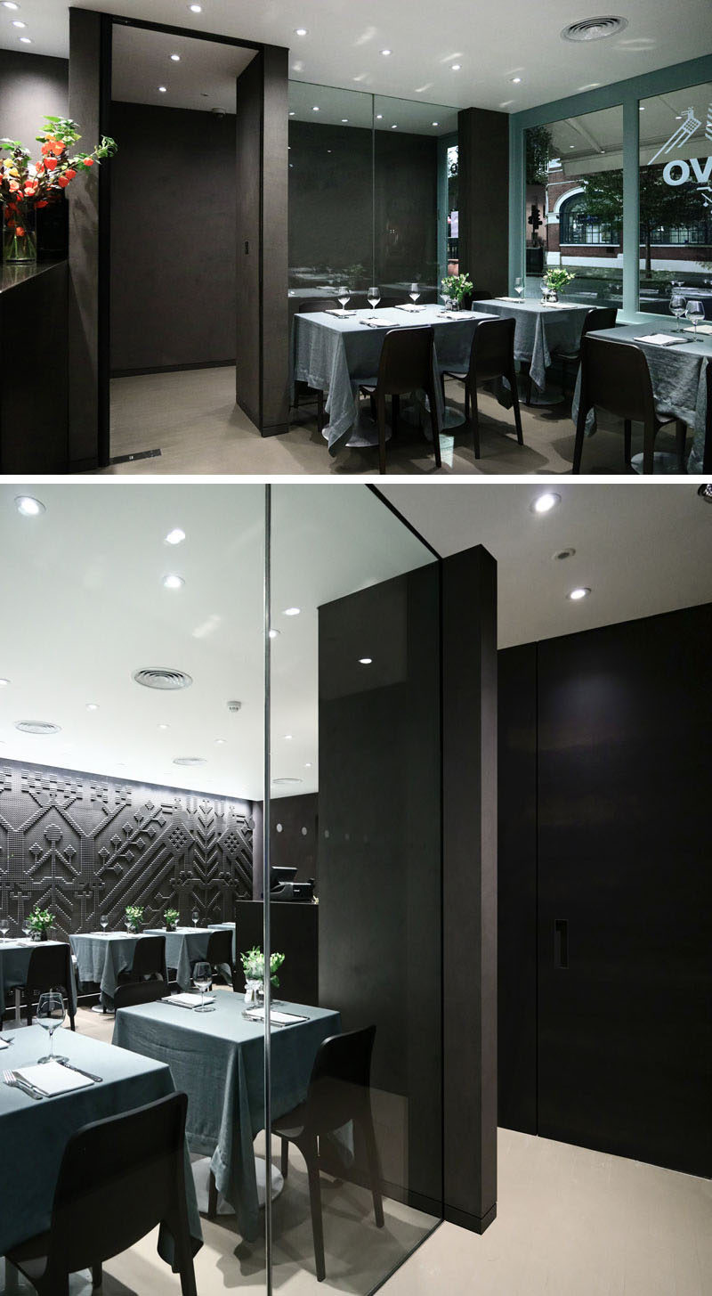 Upon entering this restaurant, you step into a small lobby area with a full height glazed wall, dividing the space from the main dining area. This glazed wall replaces what was once a solid wall, making the lobby more open and visually interesting.