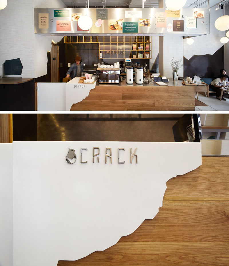 This wooden service counter is partially covered with a 'white egg shell' and the logo, that fits in with the cracked shell theme found throughout the design of the restaurant.