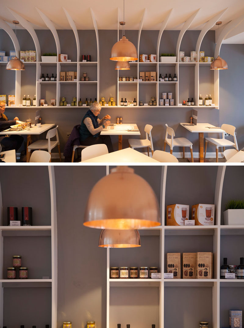 This modern restaurant interior features a large custom-designed sculptural shelving unit to display the various products that they sell.
