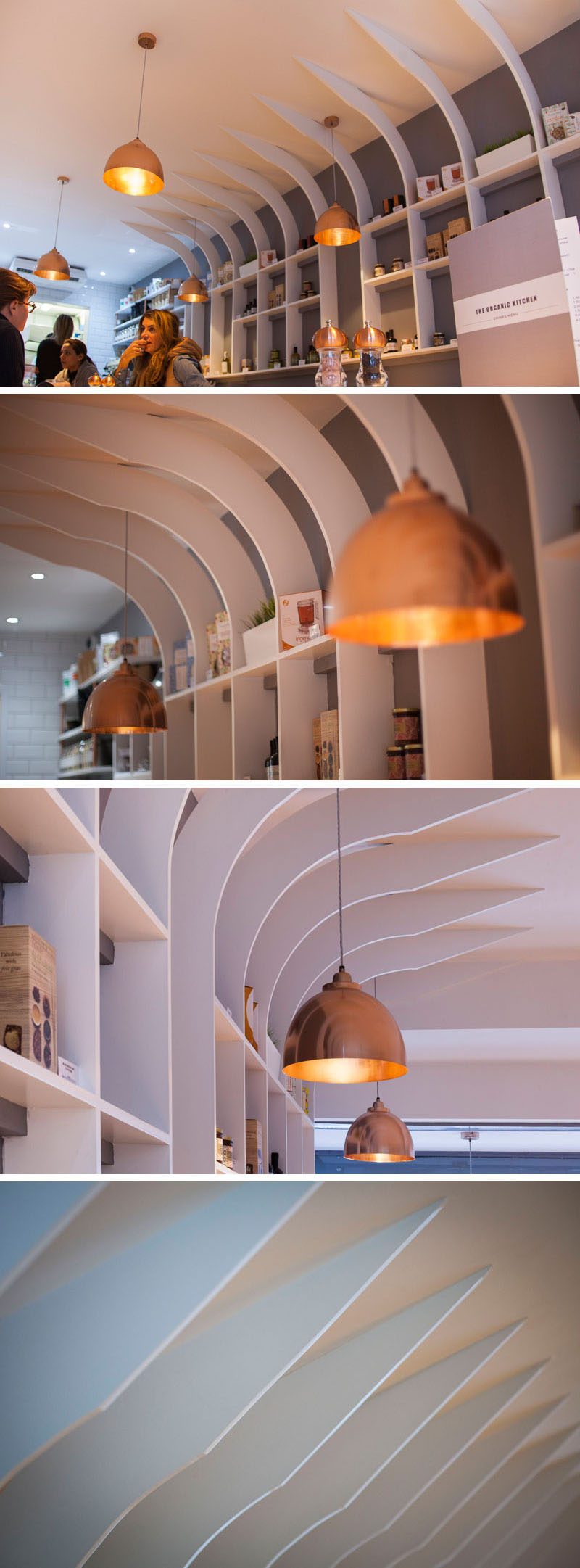 This modern restaurant interior features a copper pendant lights throughout, and a sculptural shelving unit displays the various products that they sell.