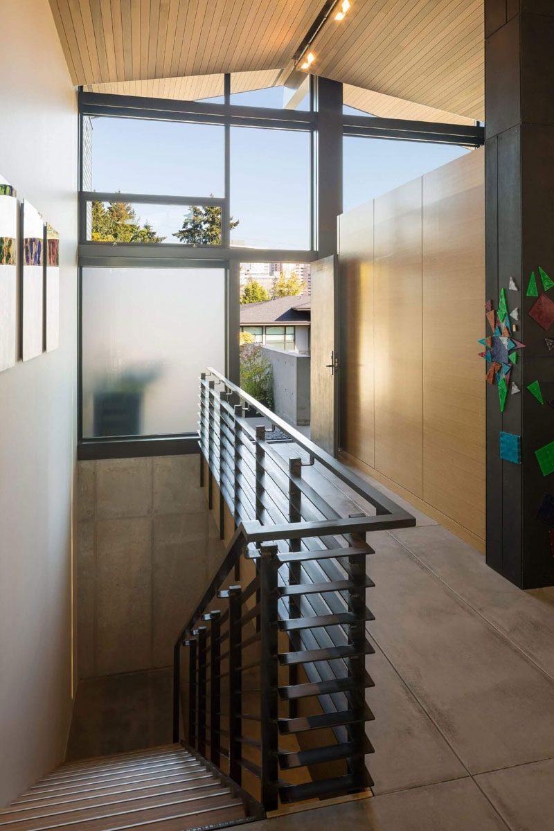 This steel staircase by entry of the home provides access to the garage.