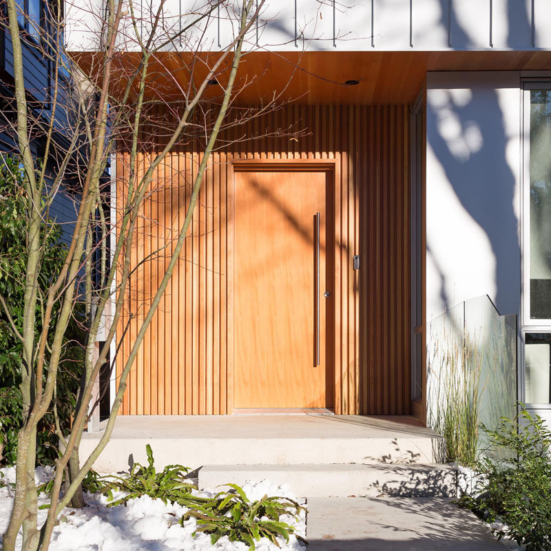 Wood surrounds the entryway and front door of this modern home. The wood used is Douglas Fir.