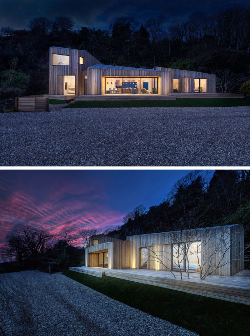 At night, this modern holiday home has uplighting on the facade creating a soft glow on the house.