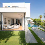 Large sliding glass walls give this house easy access to the pool