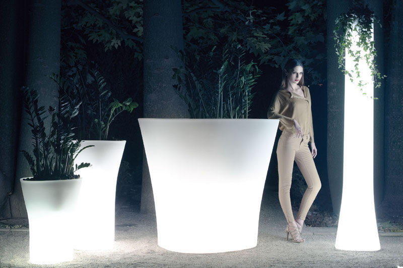 8 Outdoor Lighting Ideas To Inspire Your Spring Backyard Makeover / Pots and Planters - They come in a huge range of sizes so whether you're planting a few flowers or a massive hedge, an illuminated planter is up for the job.