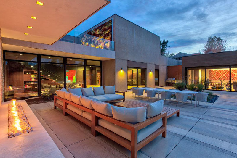This contemporary home has an outdoor living room with fireplace, and an outdoor dining room.