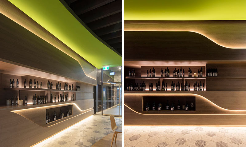 Interior Lighting Design Ideas ? A wall of hidden LED lights behind wood panels creates a warm modern glow
