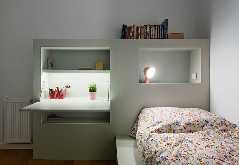 This modern kids bedroom furniture has been designed to keep things organized with built-in shelving and a fold-down homework station.