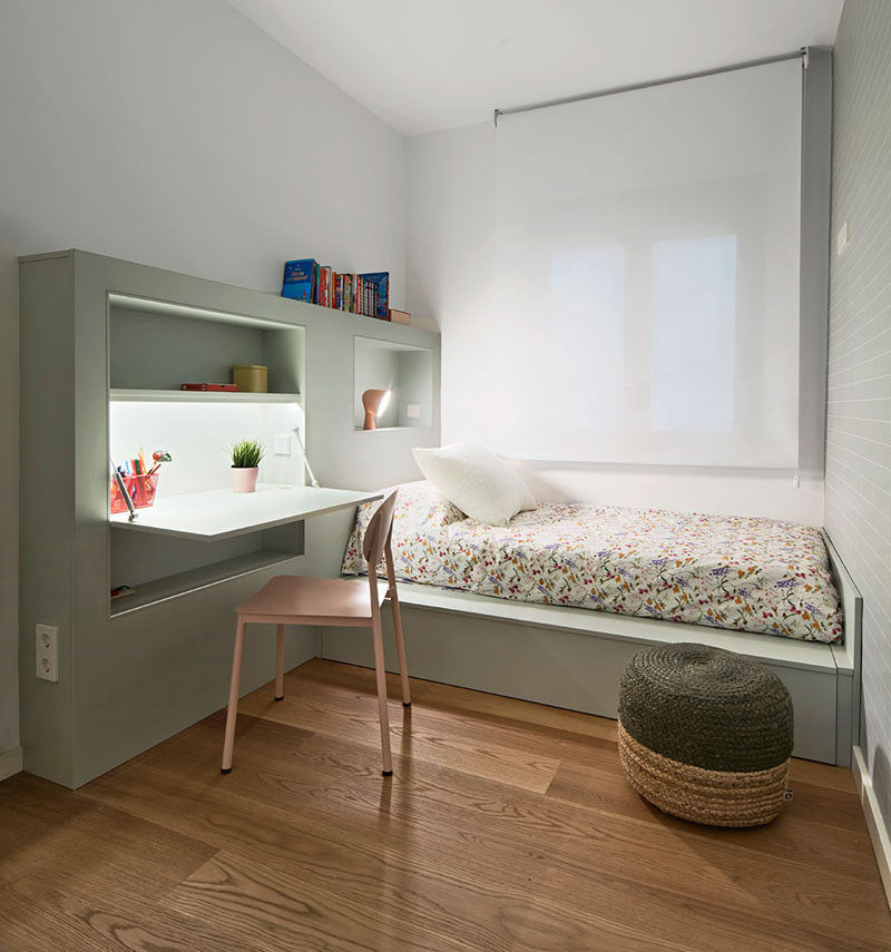 this small kids bedroom combines the bed frame a desk