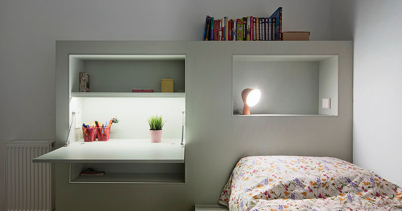 This Small Kids Bedroom Combines The Bed Frame A Desk And Shelves To Save S