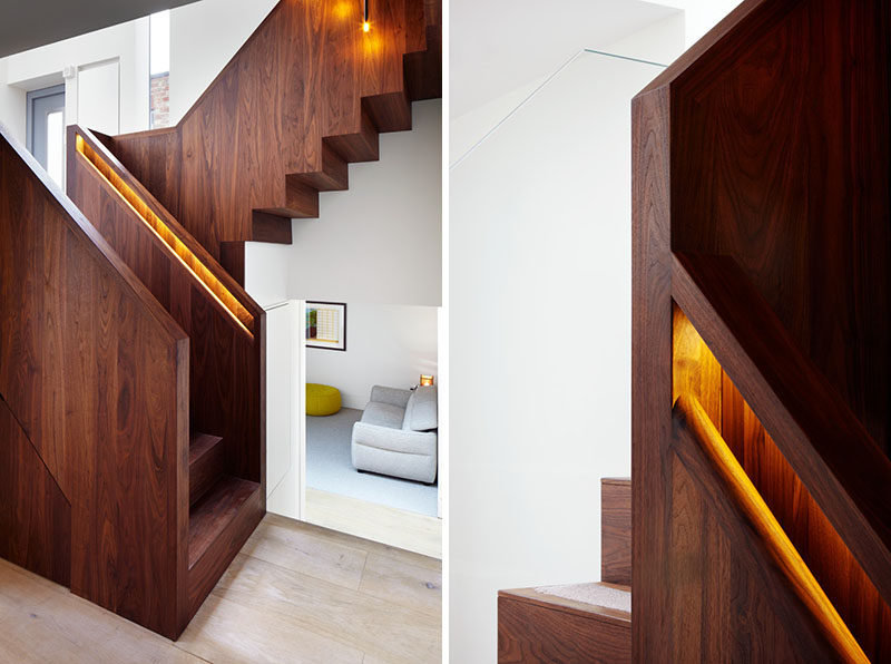 This American black walnut stairs has hidden lighting in the built-in handrails to light up the staircase and make the handrail easier to find.