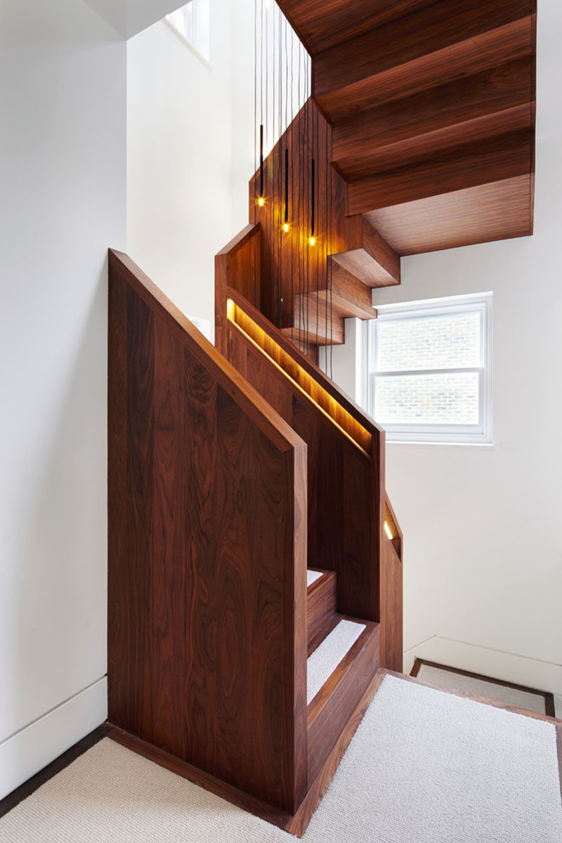 This American Black Walnut Stairs Has Hidden Lighting In The Built In  Handrails To Light