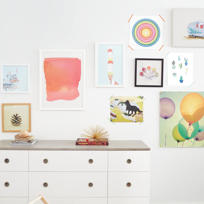 Colorful wall art is a great way to decorate a cute bedroom.