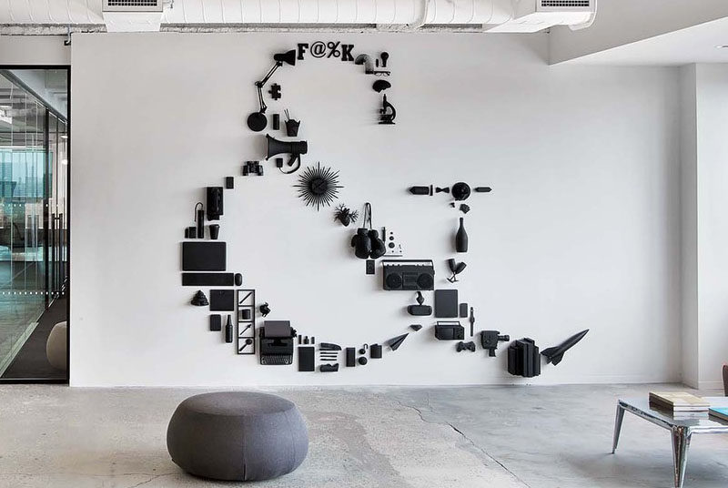 Wall Decor Ideas - What do a rocket, a pair of binoculars, a beer bottle, and a plastic heart all have in common? Not a lot, but if you paint them all the same color and carefully arrange them with other random objects, you can create a unique, contemporary matte black piece of wall art.
