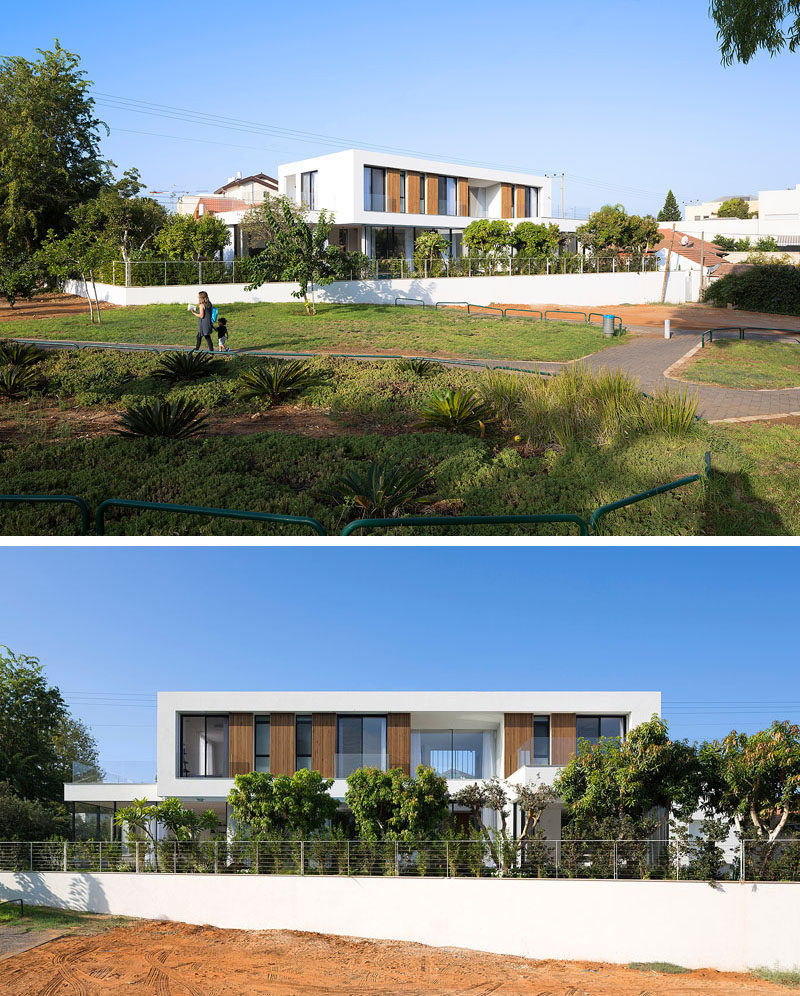 Shachar- Rozenfeld architects have designed this 'L' shaped modern home in Rishon LeZion, Israel, that sits on a narrow trapezoid lot and borders a small public park.