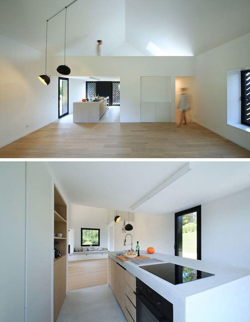 The interior of this small modern house is bright, lofty and open. Upon entering the interior, you walk into the kitchen that has an island housing the cooktop and sink. Behind the kitchen is the bathroom and above it is a mezzanine with a sleeping loft.
