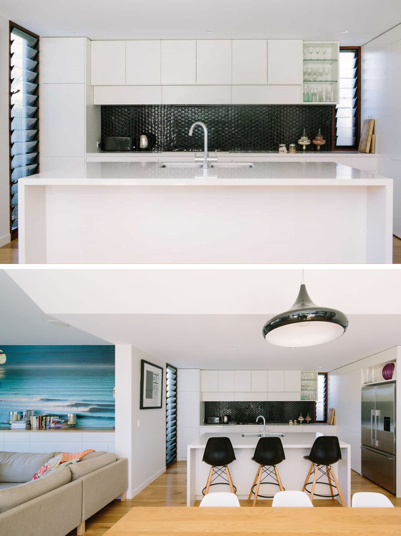 Kitchen Design Ideas - 9 Backsplash Ideas For A White Kitchen // Create a bit of contrast in your white kitchen with a super dark backsplash. Black tile is an easy way to do this but the look can also be achieved with a dark brushed metal or even a black glass.