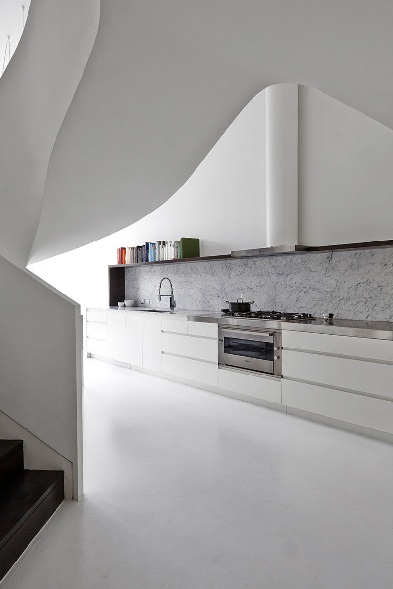 Kitchen Design Ideas - 9 Backsplash Ideas For A White Kitchen // Add a stone backsplash to an all white kitchen to compliment a stone island, continue the countertop or just stand on it's own as an accent.