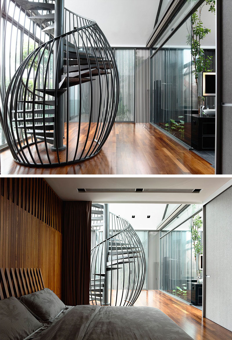 This Sculptural And Modern Black Metal Spiral Staircase Looks More Like A Birdcage With The Rods Curving Around Spiraling Steps