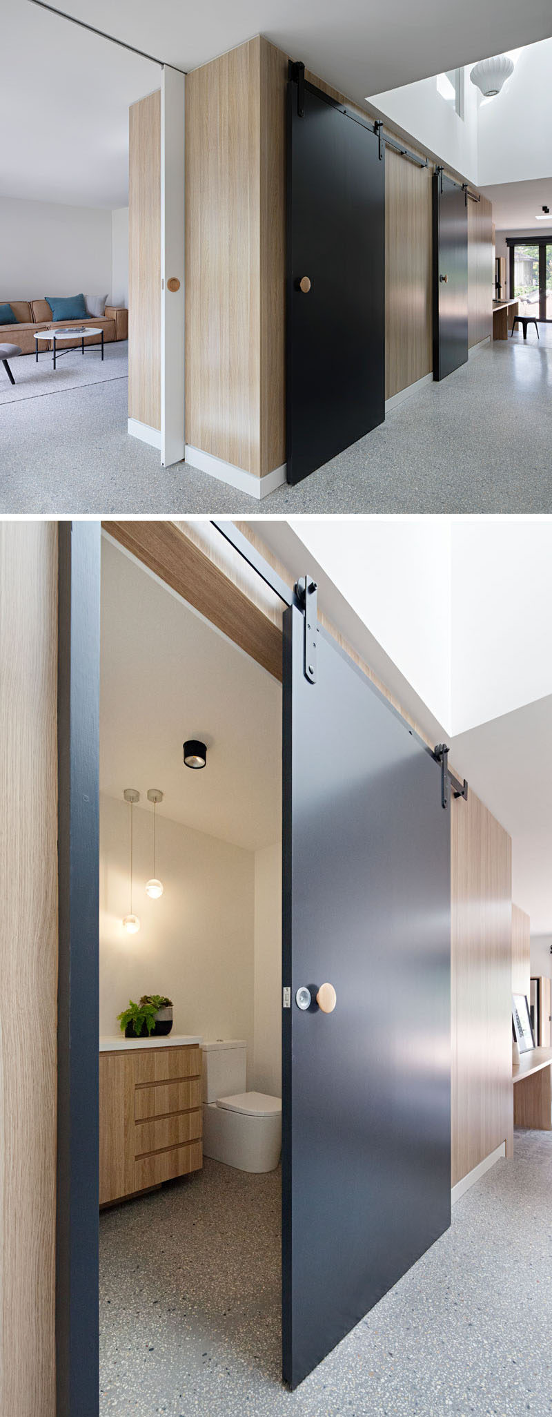 In the main floor of this modern renovated house, a central timber-clad pod has matte black sliding barn doors that conceals various rooms, like a small bathroom and cloak room.