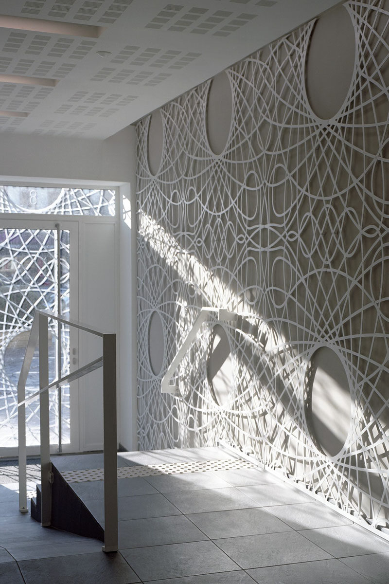 The lobby in this building features decorative concrete panels inspired by a pattern found on bank notes. The artistic panels also cover the facade of the building.
