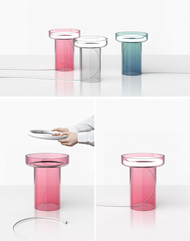 This clear, colored modern glass table lamp named HALO, has a handblown glass body with a circular light tucked inside it. HALO is available in grey, pink and blue and it is a limited edition piece.