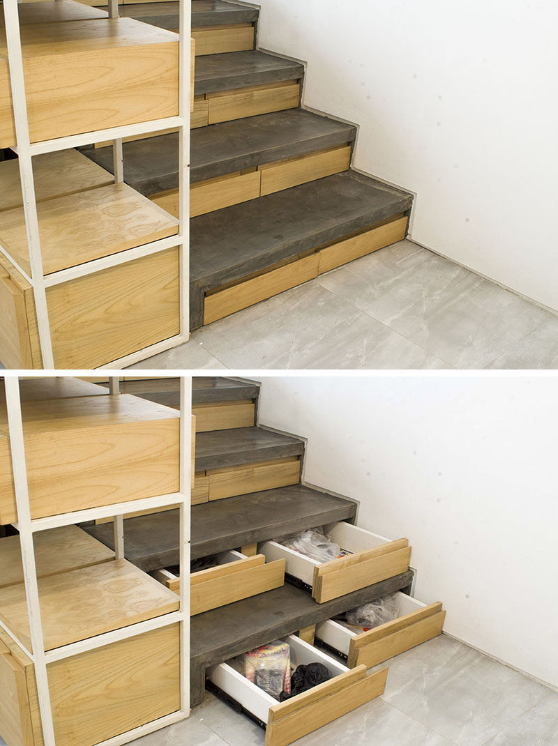 This concrete and wood staircase in a modern Indonesian house, has hidden stair storage within the concrete risers, ideal for bags, jackets and shoe storage
