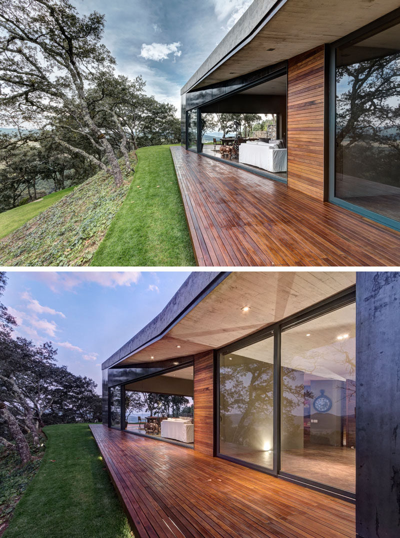 This modern house has a small wood deck that can be accessed through large sliding glass doors in the living room.